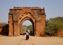 People at the gate of South Guni temple in Bagan, Myanmar Royalty Free Stock Photo