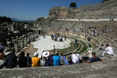 People gather amongst the Roman theatre ruins at the ancient site of Ephesus in Turkey. People gather amongst the Roman theatre ruins at the ancient site of Royalty Free Stock Photos