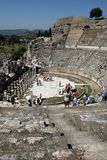 People gather amongst the Roman theatre ruins at the ancient site of Ephesus in Turkey. Royalty Free Stock Photo