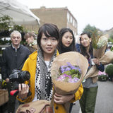 People gather at Columbia Road Flower Market in the East End of London. This market is as much social as it is about buying Royalty Free Stock Photos