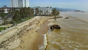 People Gather Garbage after Typhoon on Beach Upper View. Upper view people gather garbage after typhoon and floating house carried ashore against modern hotels stock video footage