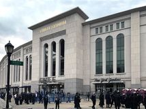 People gather outside for FDNY & NYPD game at Yankee Stadium hos Stock Photos