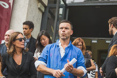 People gather outside Ferragamo fashion show building in Milan, Royalty Free Stock Photo