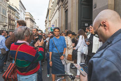 People gather outside Trussardi fashion show building in Milan, Royalty Free Stock Photo