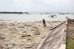 People gather plankton, crabs on the sea. Hard work in Cebu Philippines royalty free stock image