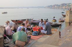 Ganges river religious chant Varanasi India. People gather for religious chant on Ganges river Varanasi India Royalty Free Stock Images