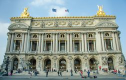 People gather on the steps of the luxurious Palais Garnier, royalty free stock photos