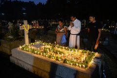 People gather to celebrate All Souls Day in Kolkata. All Souls' Day is a day when Christians remember their family, friends & relatives, who have passed stock photography