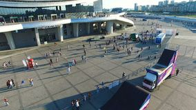 People Gather to Celebrate Event near Mall Building Aerial View. KAZAN, TATARSTAN/RUSSIA - NOVEMBER 14 2017: Aerial view people gather to celebrate special event stock video