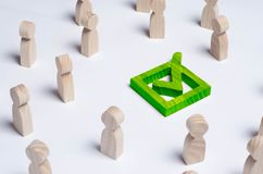 People gathered around the checkbox on a white background. People make a group choice. Democratic elections, collective decision a. Nd choice, referendum Royalty Free Stock Images