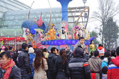 People gathered happily to watch the floats Stock Images