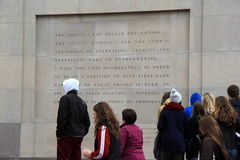 People gathered near engraved wall outside The United States Holocaust Memorial Museum,Washington,DC,2015 Royalty Free Stock Photos