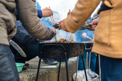 People gathering in Barbeque Royalty Free Stock Photo
