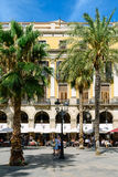 People Gathering In Royal Square Placa Reial or Plaza Real a Well-Known Tourist Attraction Of Barcelona. BARCELONA, SPAIN - AUGUST 05, 2016: People Gathering In Stock Images