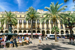 People Gathering In Royal Square Placa Reial or Plaza Real a Well-Known Tourist Attraction Of Barcelona. BARCELONA, SPAIN - AUGUST 05, 2016: People Gathering In Stock Photo