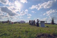People gathering in rural area to celebrate summer solstice festival. Mikrorayon Svetlyy, Novosibirsk Oblast, Russia, June 21, 2018: People gathering in rural stock photo