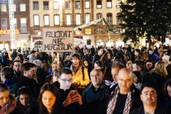 People gathering in solidarity with victims from Paris assaults. STRASBOURG, FRANCE - NOV 18, 2015: Fluctuat Nec Mergitur placard with people gathering, placing stock photo