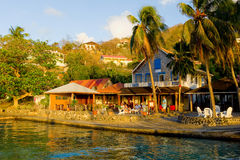 People gathering at sunset along the waterfront on bequia Royalty Free Stock Photography