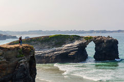 People gazing landscape near cliffs in beach of cathedrals Royalty Free Stock Images