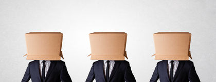 People gesturing with empty box on their head. Group of people gesturing with empty box on their head Royalty Free Stock Photo