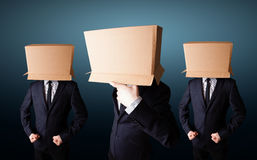 People gesturing with empty box on their head. Group of people gesturing with empty box on their head Royalty Free Stock Images