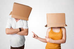 People gesturing with empty box on their head Royalty Free Stock Images