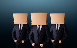 People gesturing with empty box on their head Stock Images