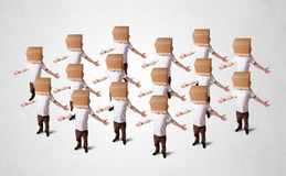 People gesturing with empty box on their head Royalty Free Stock Image