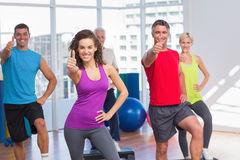 People gesturing thumbs up in fitness class Stock Images