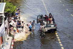 People get into a car on a flooded station Royalty Free Stock Images