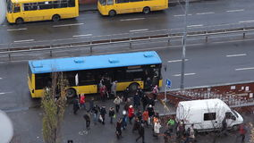 People get out the bus at the bus stop stock footage
