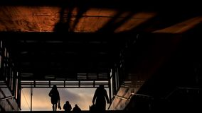 People get out from subway at winter sunset, silhouette stock video
