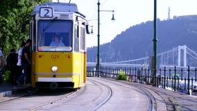 People get on tram stock video footage