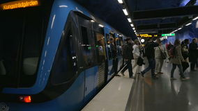 People getting off the subway train. STOCKHOLM, SWEDEN - APRIL 26, 2015: Slow motion clip of passengers getting off the modern train at the metro station stock video