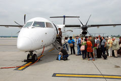 People getting on the plane royalty free stock image