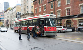 People getting on a Toronto streetcar Royalty Free Stock Photo