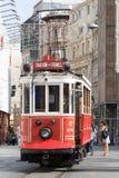 People getting on the vintage tram in the Beyoglu area. Istanbul, Turkey - September 22nd 2015: People getting on the vintage tram in the Beyoglu area. This is royalty free stock image
