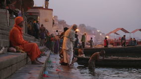 People at ghats of the Ganges river in Varanasi at sunset. VARANASI, INDIA - 22 FEBRUARY 2015: People at ghat of Ganges river in Varanasi at sunset stock video footage