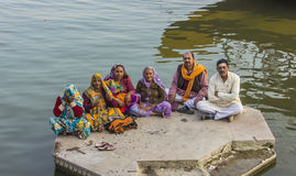 People on the ghats. An indian family is sitting at the water f the ganges Stock Photo