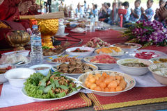 People give food and drink for alms to Buddhist monks. Thai food Royalty Free Stock Photo