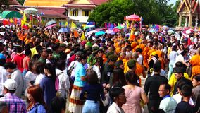 People give food offerings to Buddhist monks. stock footage