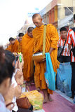 People give food offerings to monks Stock Image