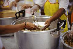 People Give Food To Hungry Homeless Poor, Get Free Food to Give Out to the Homeless and Hungry.  stock photography