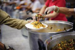 People Give Food To Hungry Homeless Poor, Get Free Food to Give Out to the Homeless and Hungry.  royalty free stock image