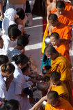 People gives food offering to Buddhist monk. Royalty Free Stock Image