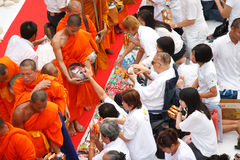 People Gives Food Offerings To A Buddhist Monk Royalty Free Stock Photos