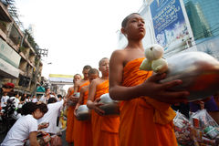 People Gives food offerings to a Buddhist monk Stock Image