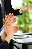 People giving applause. Group of people giving applause in seminar or presentation stock images