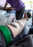 People are giving blood donation. This is giving blood donation Stock Photo