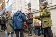 People giving leaflets at Anti UKIP market stall in Thanet South. People looking at leaflets at an Anti UKIP and Farage stall in Ramsgate, Thanet South during Royalty Free Stock Photography